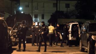 Spanish police patrol the streets of Albalate del Arzobispo in Teruel province after three people, including two police officers, were killed.