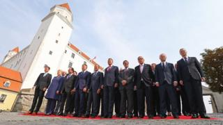 Heads of state and government of the 27 EU member countries gather for a group photo call at the Bratislava castle during the EU summit on Friday