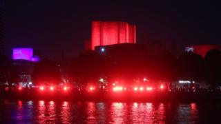 National Theatre lit up in red
