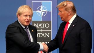 Donald Trump UK Prime Minister Boris Johnson shakes hands with US President Donald Trump during the annual Nato heads of government summit in Watford, England, 4 December 2019