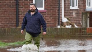 A man walks through flood water in East Cowick