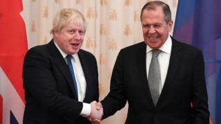 Boris Johnson shakes hands with Sergei Lavrov