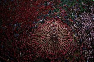 Members of Vella de Xiquets de Valls try to complete their human tower during the 26th Human Tower Competition in Tarragona, Spain, on 2 October 2016.