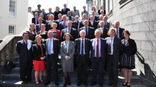 The 38 successful Guernsey election candidates on the steps of the States building