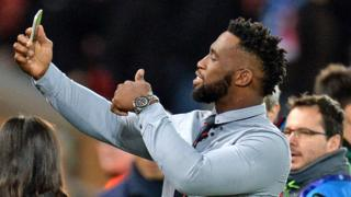 in_pictures South Africa rugby captain Siya Kolisi taking a selfie at Anfield in Liverpool - Wednesday 27 November 2019