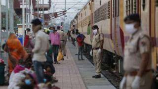 Migrant workers deboard from a special train that arrived from Nasik during a government-imposed nationwide lockdown as a preventive measure against the COVID-19.