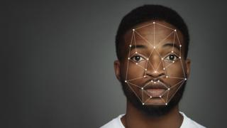 Technology Black man with facial recognition algorithms