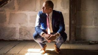 Belgian Immigration Minister Theo Francken squats in an empty office after he claims bailiffs took furniture over his refusal to pay fines relating to the case of the Syrian family (image from Facebook)