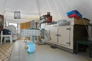 Interior view of a renovated bunker showing a kitchen