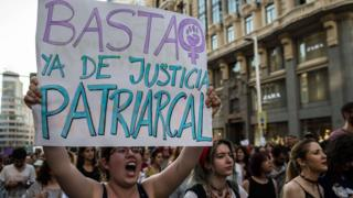 """A protester holds a placard that reads """"enough of patriarchal justice"""" during a protest against court's decision to release 'wolf pack' gang on bail. 22 June 2018"""