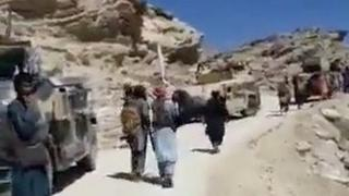 Men thought to be Taliban fighters near the entrance to the Panjshir valley
