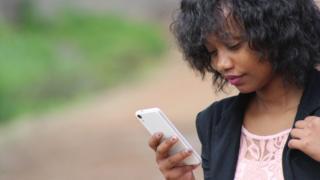 Woman wey dey use phone