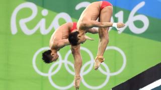 Aisen Chen and Yue Lin of China compete in the Men's Diving Synchronised 10m Platform Final