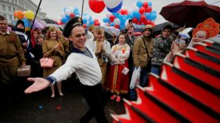 A man wearing a navy uniform performs before a May Day rally in central Moscow, Russia May 1, 2018.