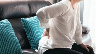 Woman with a sore back
