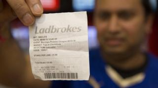 Leicester fan with betting slip