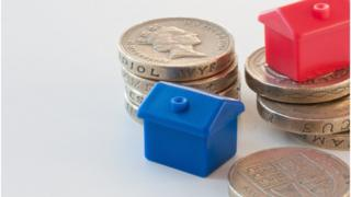 Toy homes on pound coins