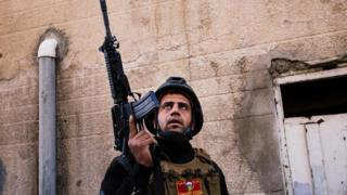 A member of the Iraqi special forces Counter Terrorism Service (CTS) holds a position in Mosul's al-Jazair neighbourhood on January 17, 2017,