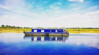A canal boat on the Thames at Port Meadow
