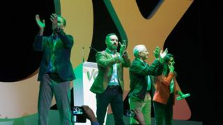 Santiago Abascal, the general secretary of Vox (C), Jose Ostega Smith, Rocio Monasterio and Ortega Lara are seen on the same stage giving thanks to the audience during the rally