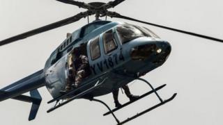 เฮลิคอปเตอร์ของกองกำลังรักษาความปลอดภัยบินเหนือเมืองวาเลนเซีย