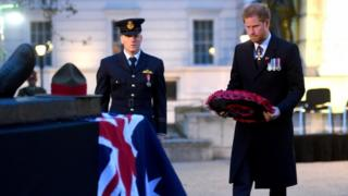 Prince Harry laying a wreath at the Anzac Day dawn service