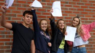 GCSE students Nathan Moffett, Victoria Lloyd, Alison Riley and Zoe Jess from Grosvenor Grammar School, Belfast, celebrating their results