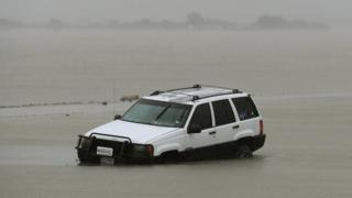 Big car dey sink inside flooding for Texas