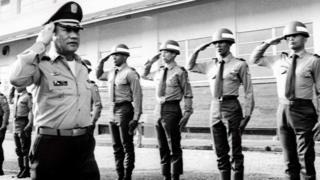 Panama's General Manuel Noriega with troops in 1985