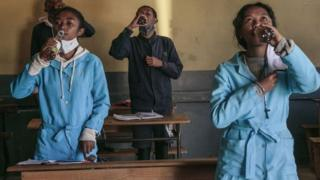 Students at Antananarivo school drinking Covid-Organics