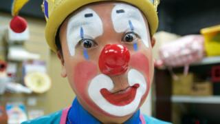 Kenneth Ng as Ken Ken, his clown alter ego