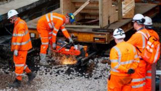 Workers installing rail track