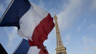 French flags fly at half mast