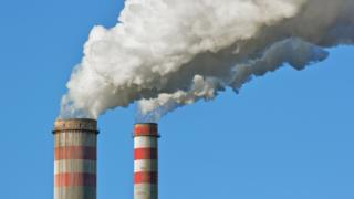 Stock image of a coal power plant smoke stack