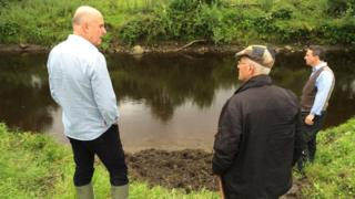 Barney Devine. Maurice Owens and Paul Logue at the place where the sword was found