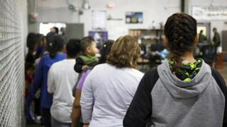 Illegal migrants line up at the McAllen site
