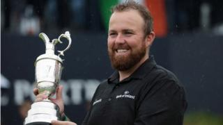 Shane Lowry of Ireland with the claret jug trophy as he celebrates winning the British Open Golf Championship at Royal Portrush, Northern Ireland, 21 July 2019.