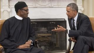 US President Barack Obama speaks with Nigerian President Muhammadu Buhari during a meeting in the Oval Office of the White House in Washington, DC, July 20, 2015.
