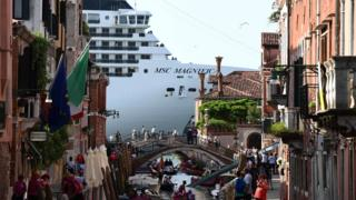 The MSC Magnifica is seen from one of the canals leading into the Venice Lagoon