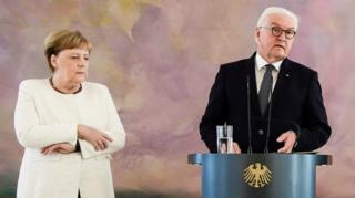 German Chancellor Angela Merkel (L) grips her arms next to German President Frank-Walter Steinmeier while attending the handing over of the certificates of appointment and discharge for the Ministers of Justice at Bellevue Palace in Berlin, Germany, 27 June 2019