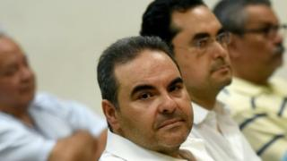 Former Salvadoran President (2004-2009) Elias Antonio Saca waits for the judge to arrive in court in San Salvador, on November 1, 2016.