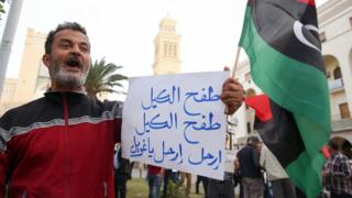 Supporter of Libya's new prime minister-designate Fayez al-Sarraj