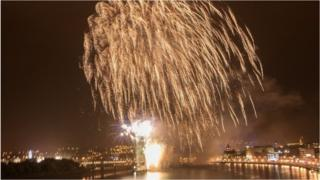 Crowds lined the city's quay to watch the fireworks display