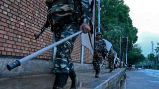 Security personnel patrol during a lockdown in Srinagar