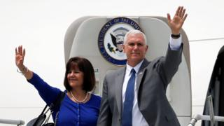 Mike Pence and his wife Karen wave for the cameras
