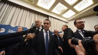"Italy""s populist Five Star Movement (M5S) party leader Luigi Di Maio (C), arrives to give a press conference a day after Italy""s general elections, on March 5, 2018 in Rome"