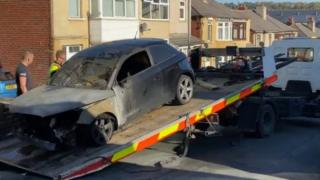 Burnt out car at the scene