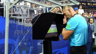 Referee Nestor Pitana reviews VAR footage before awarding France a penalty during the 2018 FIFA World Cup Final.