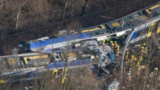 aerial view of trains that have crashed into each other