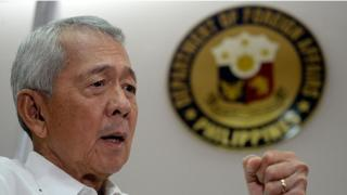 Philippine Foreign Secretary Perfecto Yasay gestures during an interview in Manila on July 8, 2016.